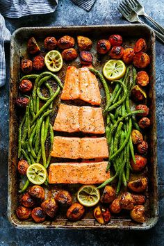 This 5 Ingredient Sheet Pan Salmon is the perfect dinner for busy weeknights! This complete seafood dinner cooks in just 30 minutes and the cleanup is easy too! Who doesn't love a great one-pan meal? Salmon Recipes, Fish Recipes, Seafood Recipes, Cooking Recipes, Healthy Recipes, Cooking Hacks, Salmon Dinner, Seafood Dinner, Easy Dinner Recipes
