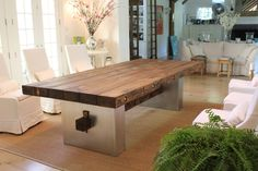 A metal base gives this rustic barnwood table and upscale and polished feel.