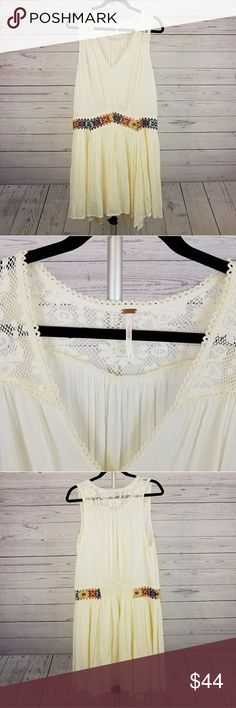 Free People Dress With Lace Accent Size Large This is a beautiful dress by Free People with stylish embroidered lace accent around the waist area in size large. Free People Dresses
