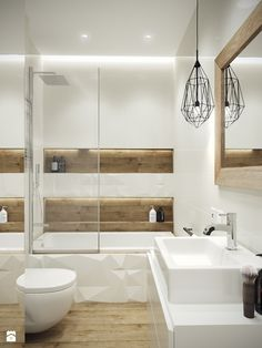 We like this incorporation of wood as shelving into shower as well