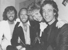 the brothers with Maurice's ex wife Lulu in the 80s