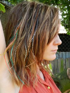 PARADISE: http://www.aheadofhair.biz/feather-hair-extensions-mixed-colours/feather-hair-extension-paradise--feather-extension-paradise.html And Tribal fusion:http://www.aheadofhair.biz/feather-your-heads-the-naturals/feather-hair-extension-tribal-fusion--feather-extensions-tribal.html