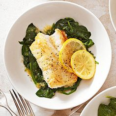 1 pound fresh or frozen cod or other firm white fish 2 small lemons 1 tablespoon grated fresh ginger 2 teaspoons sugar 1/4 cup butter 2 5 ounce bags baby spinach 2 tablespoons water 1/4 teaspoon salt 1/4 teaspoon ground black pepper Lemon-Ginger Fish