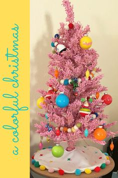 Learn how to create a colorful Christmas theme for your home. Grab your paints, clear ornaments, and turn up the holiday tunes! Pink Christmas Tree, Merry Christmas To All, Christmas Themes, Christmas Lights, Holiday Decor, Ikea Mats, Cricut Banner, Clear Plastic Ornaments, Best Housewarming Gifts