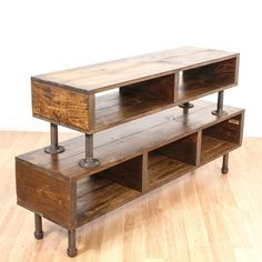 This industrial entertainment center is featured in a solid wood with a dark rustic finish. This display shelf is in good condition with 2 box tiers and metal details with a patina finish. Stylish and modern media center perfect for a tv! #industrial #storage #mediacenter #sandiegovintage #vintagefurniture