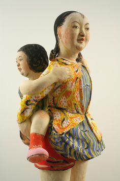 Girl in Yellow Jacket by Akio Takamori