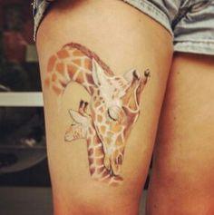 Momma and baby giraffe tattoo.
