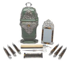 A CONTINENTAL SILVER-MOUNTED SHAGREEN GENTLEMAN'S SHAVING ETUI, possibly Portuguese,  circa 1730-40 -  applied with baroque silver plaques, fitted with engraved silver-mounted fittings comprising tortoiseshell-framed mirror with arched top, stone strop, steel-bladed scissors, tortoiseshell comb and six razors scissors stamped V below a crown, the later razor blades 'E. Turner 113 St John St' height overall 12in.