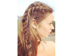 @Byrdie Beauty - Parted Plait    Have long tresses? This reverse crown braid is for you!