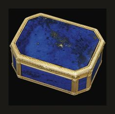 A LOUIS XV TWO-COLOUR GOLD AND LAPIS-LAZULI SNUFF-BOX MAKER'S MARK OF PIERRE-FRANCOIS DRAIS, PARIS, 1771-1772 Oblong with cut corners, the cover, base and sides set à cage d'or with ten lapis-lazuli panels, the mounts chased with laurel swags and foliage, the cover with a foliate border. COLLECTION YVES SAINT LAURENT ET PIERRE BERGÉ.
