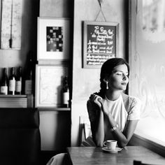 no idea where but I suspect france with that coffee cup and wine .... she's so peaceful looking