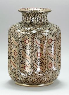 """ZSOLNAY EOSIN-GLAZED VASE Pecs, Hungary, Late 19th/Early 20th Century Paneled and dimpled body with allover decoration of stylized foliage. Stamped red five churches mark and incised 4939. Height 14.75"""". 16/L2625U"""