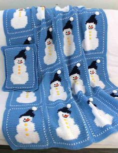 The winter holidays aren't complete without some snow and a cozy crochet afghan. Even if you don't get snow in your area, the Snowman Afghan and Pillow Pattern is the perfect accessory for you home. Snuggle up with a warm cup of hot chocolate under this cozy throw covered with cute snowman. The light blue color gives the impression of a pretty blue sky.