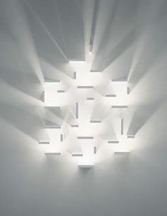 """Some designs with minimalist forms carried maximum impact, such as Set by J. Ll. Xuclà for Vibia. The wall sconce series is described as a """"game"""" for how the fixtures can use light and shadow to create the illusion of volume. Endless combinations can fill spaces both large and small. www.vibia.com"""