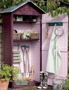 I doubt my hubby would appreciate this PINK interior, but I love the idea of the tiny shed to hold lawn supplies.  I may have to figure this out with some pallets.... lol!