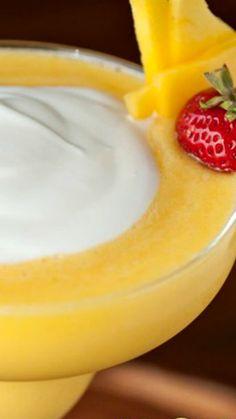 Mango Coconut Daiquiri ~ Refreshing tropical daiquiri made with fresh mango, coconut rum, and coconut cream
