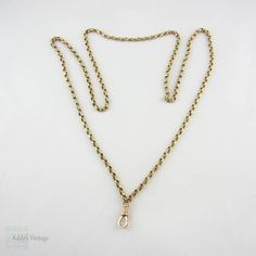 (http://www.addysvintage.co.uk/victorian-9-carat-gold-guard-chain-belcher-link-antique-long-gold-chain-with-dog-clip-for-watch-or-fob-80-cm-31-5-inches-20-3-grams/) Love gold chains!  And this one is a great length!