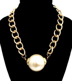 Stylish gold chain with a cream pearl pendant
