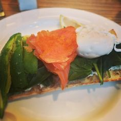 Healthy breakfast - Salmon, avocado stack with poach egg and spinach