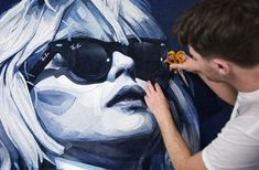 Denimu aka Ian Berry. Art in Denim - Ray Ban District 1937 The piece made over several weeks in Ian Berry's Swedish studio using varying shades of denim jeans measured 244cm x 130cm