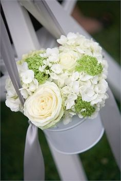 Hanging basket of white and green flowers to decorate an outdoor wedding