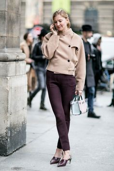 Maroon pants and asymmetrical heels  | for more style inspiration visit 40plusstyle.com