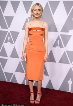 Saoirse Ronan flashes cleavage in cut-out orange dress | Daily Mail Online