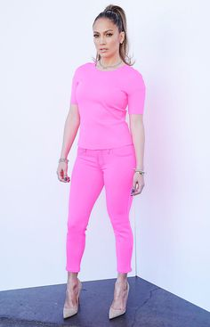 MARCH 12, 2014 Lopez wowed in hot pink J. Brand neon jeans and a matching scuba top also by the brand, which she paired with nude Christian Louboutin pumps.