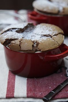 Chocolate souffle. 6 tablespoons unsalted butter  8 ounces Hershey's milk chocolate chips  6 eggs, separated  3/4 cup sugar  powdered sugar - dusting