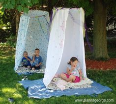 Hang a hula hoop from a tree and attach a shower curtain... or for MY BOYS, camo netting!!!