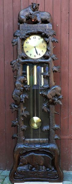 a carved wood grandfather clock with bears, swiss 1930s.