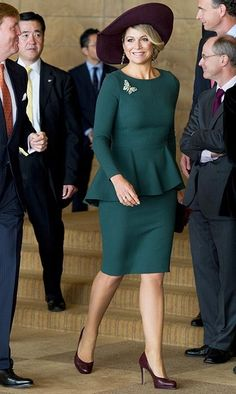 For an energy conference the following day, Máxima chose a forest-green peplum number paired with burgundy pumps and a matching, wide-brimmed hat. (Photo by Patrick Van Katwijk/DPA/ZUMA/Keystone)