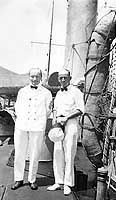 USS Walke (Destroyer # 34)  Chief Electrician and another Chief Petty Officer standing by one of the ship's life rafts, amidships, circa 1914.