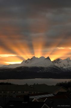 Incredible view, Sun rays over mountains at sunset.