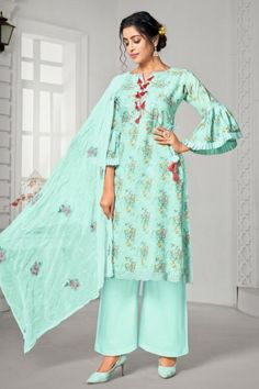 Look gorgeous in this turquoise blue cotton trouser suit which surely deserves a special place in your wardrobe. This v neck and 3/4th sleeves attire is elaborated using floral print work. Set together with cotton plazzo pant in turquoise blue color with turquoise blue chiffon dupatta. This trouser suit can be customized up to maximum size 44 inches. #Cotton #Trousersuit #Malaysia #Andaazfashion