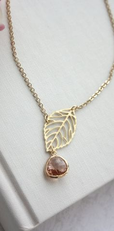 Version w/out bulky leaf and prettier, delicate chain, maybe tiny rolo?  Gold or copper Rutilated focal bead w/a few same rondelles interspersed throughout chain or 4-7 in a row somewhere on side, or mall numbers of together through the chain randomly?