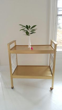 Lovely vintage bar cart. Fun Marrakesh design. All wood. Painted gold and white😍. Refreshing and fun.  30x 17.5 x 33  ☻please contact me for shipping before ordering, I will need your zip code to give you a price. 🙂I am located in Central NJ. Delivery and pick up are available. 💜if you are looking for a particular piece of furniture let me know, I may be able to get it and custom paint it for you