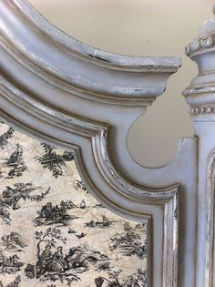 She painted right over the original wood finish with OLD WHITE, then layered PARIS GREY over that. She used CLEAR WAX and distressed it. Allowing the OLD WHITE and the wood finish beneath it all to peak through. She then sealed it with a little more CLEAR WAX, followed by the DARK WAX.