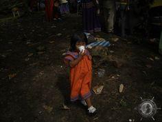 a little indian girl in orange in costa rica
