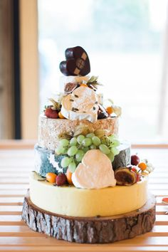 Cheese Tower Wedding Cake - Greenery Filled Tipi Wedding in Cheshire With Flowers By Frog Manchester And Tipi From Big Chief Tipis Bride In Pronovias And Bridesmaids In Floral ASOS Dresses With Images From Melissa Beattie