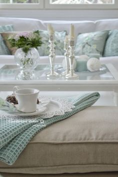 The subtle splashes of pale aqua lend tranquility and tie it all together.