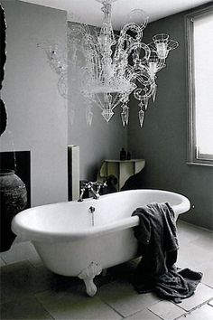this bathroom features a large chandelier over the bathtub