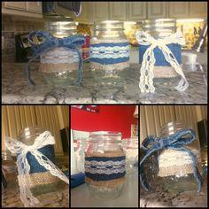Wedding decoration. Mason jars with lace, burlap, and denim. Rustic wedding.