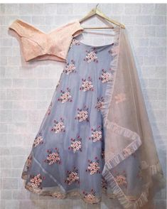 Grey and Peach off shoulder Lehenga Choli Features a banglori silk blouse with chikanakari work alongwith organza lehenga with can can layered.Comes with organza dupatta. Lehenga Choli Designs, Indian Lehenga, Blue Lehenga, Kids Lehenga, Grey Saree, Net Lehenga, Indian Attire, Indian Ethnic Wear, Indian Dresses