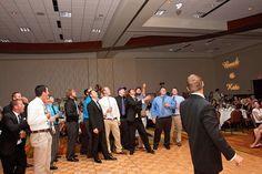 The garter toss, at Jumer's Casino Rock Island.  Monogram lighting by Marske Music Productions, www.marskemusic.com