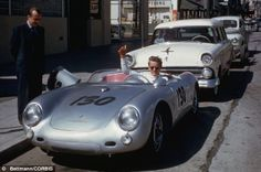 James Dean gives the thumbs-up sign from the car while parked on Vine Street in Hollywood.