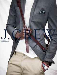 white tee khakis and grey sports jacket
