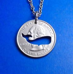Here is a hand made whale that has been cut from a Washington quarter. This cut coin is available as a necklace, pendant or key ring. Coins can also be used as zipper pulls, charms, or lots of other things. The price includes your choice of a chain or key ring. Samples of these can be seen in the last picture. If youd like a different length than offered just let me know when you place your order. You can choose other coins with most designs. Please note that golden dollars do not have any…