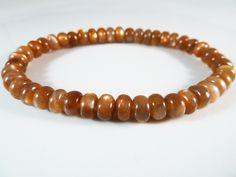 Sunstone Stretch Bracelet Golden Smooth Round Beads 10mm Glow Flash by SandiLaneFineArt on Etsy