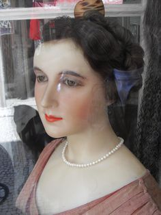 Beautiful wax model in Port wigmakers window display. The owner was inside the shop threading hair by hand. Should have taken some photographs!!